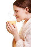 Woman smelling her cup of coffee Royalty Free Stock Images
