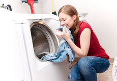 Woman smelling laundry Royalty Free Stock Photos