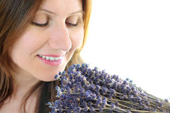 Woman smelling lavender Stock Images