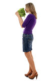 Woman smelling lettuce Stock Images