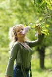 Woman smelling lilac Stock Image