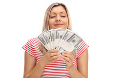 Woman smelling money Royalty Free Stock Photography