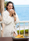Woman smelling morning coffee Stock Photography