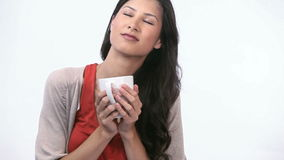 Woman smelling a mug Stock Photo