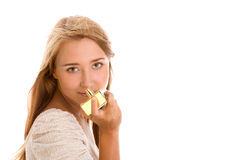 Woman smelling perfume Stock Photos