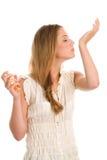Woman smelling perfume Royalty Free Stock Photos