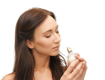 Woman smelling perfume royalty free stock images