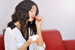 Woman smelling perfume Stock Image