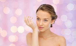Woman smelling perfume from wrist of her hand Royalty Free Stock Photography