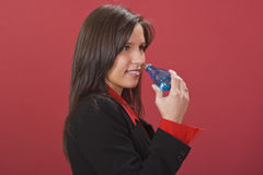 Woman smelling perfumme Stock Images