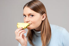 Woman smelling pineapple Royalty Free Stock Photo