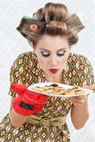 Woman Smelling Plate Of Cookies Royalty Free Stock Photography