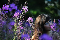 Woman Smelling Purple Flowers Royalty Free Stock Image