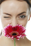 Woman smelling a red flower Stock Images