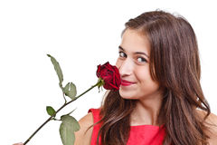 Woman smelling red rose Royalty Free Stock Photography