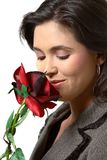 Woman smelling rose Stock Images