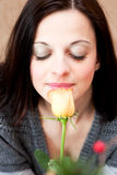 Woman smelling a rose Royalty Free Stock Images