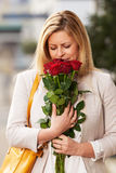 Woman smelling roses Royalty Free Stock Photo
