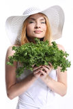 Woman smelling salad Stock Photography