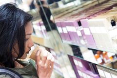 Woman smelling the scented candle at shop Royalty Free Stock Photo