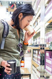 Woman smelling the scented candle at shop. Paris Royalty Free Stock Image