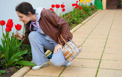 Woman Smelling spring flowers Royalty Free Stock Photo
