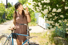 Woman smelling spring flowers Stock Image