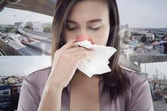 Woman smelling toxic smoke on city background. Dust allergies symptoms stock photos