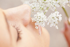 Woman smelling white flower Royalty Free Stock Images