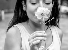 Woman Smelling White Rose stock images