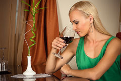 Woman smelling a wine in a glass Stock Images