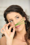 Woman smellinggrass Stock Photo