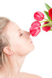 Woman smells bunch of flowers Stock Images