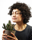 Woman smells a cactus Royalty Free Stock Images
