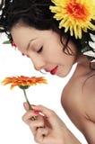 Woman smells flower Stock Photo