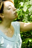 Woman smells flowering tree Stock Photo