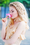Woman smells rose flower Stock Images