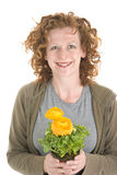 Woman  smells yellow plant Royalty Free Stock Photography