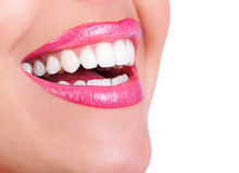 Woman smile. Beautiful young woman teeth. Isolated over  white background Stock Image