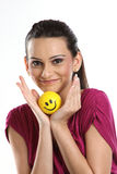 Woman with smile ball Stock Images
