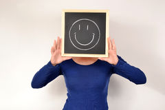 Woman with smile in blackboard Stock Photos