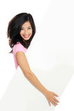 Woman smile brightly holding white blank board Royalty Free Stock Photography