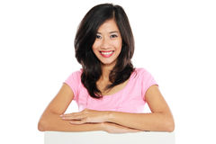 Woman smile brightly holding white blank board Stock Images