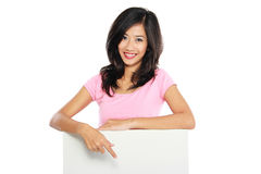 Woman smile brightly holding white blank board Royalty Free Stock Image