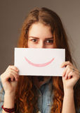 Woman with a smile card (emotion, gestures) Stock Photos