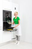 Woman smile cook meal at home kitchen Royalty Free Stock Photography