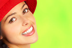 Woman smile face. Smiling woman face. Close up. Over green background stock image