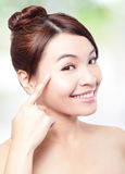 Woman smile face and finger point to eyes Stock Photos