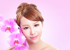 Woman smile face with orchid flowers Stock Images