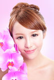 Woman smile face with orchid flowers Royalty Free Stock Photo